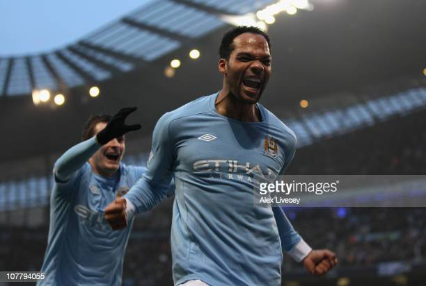 Joleon Lescott of Manchester City celebrates after scoring the second goal during the Barclays Premier League match between Manchester City and Aston...