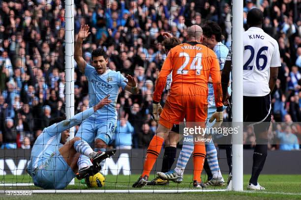 Joleon Lescott of Manchester City celebrates scoring his team's second goal during the Barclays Premier League match between Manchester City and...