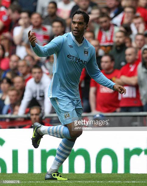 Joleon Lescott of Manchester City celebrates scoring their first goal during the FA Community Shield match between Manchester City and Manchester...