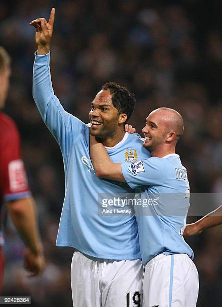 Joleon Lescott of Manchester City celebrates with Stephen Ireland after scoring his goal during the Carling Cup 4th Round match between Manchester...