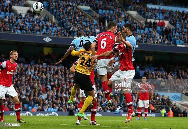Joleon Lescott of Manchester City heads the first goal during the Barclays Premier League match between Manchester City and Arsenal at Etihad Stadium...