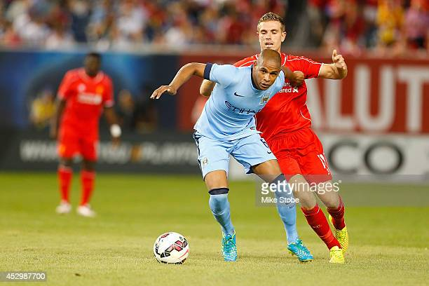 Joleon Lescott of Manchester City in action against Jordan Henderson of Liverpool during the International Champions Cup 2014 at Yankee Stadium on...