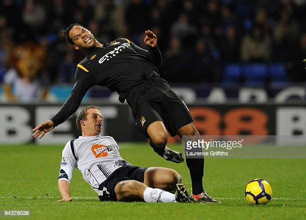 Joleon Lescott of Manchester City is fouled by Kevin Nolan of Bolton during the Barclays Premier League match between Bolton Wanderers and Manchester...