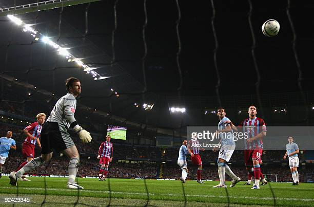 Joleon Lescott of Manchester City scores his goal past Joe Murphy of Scunthorpe United during the Carling Cup 4th Round match between Manchester City...