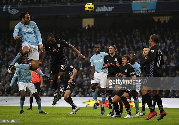 Joleon Lescott of Manchester City scores the second goal with a header during the Barclays Premier League match between Manchester City and Aston...