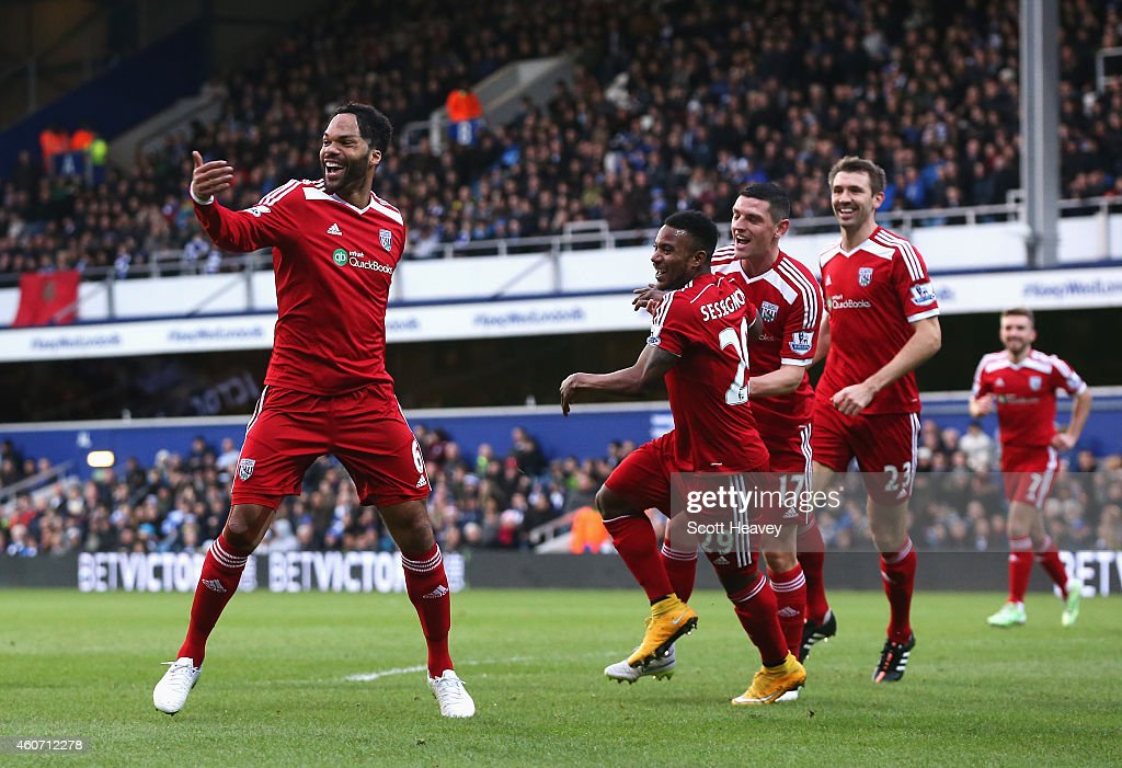 Joleon Lescott of West Brom celebrates scoring the opening goal during the Barclays Premier League match between Queens Park Rangers and West Bromwich Albion at Loftus Road on December 20, 2014 in London, England.