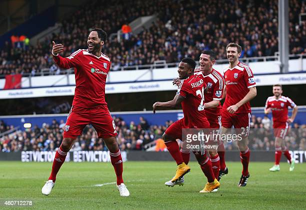 Joleon Lescott of West Brom celebrates scoring the opening goal during the Barclays Premier League match between Queens Park Rangers and West...