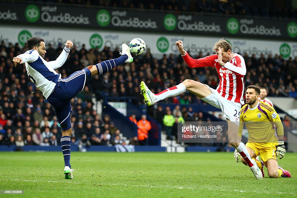 Joleon Lescott of West Brom clashes with Peter Crouch of Stoke City (R) during the Barclays Premier League match between West Bromwich Albion and Stoke City at The Hawthorns on March 14, 2015 in West Bromwich, England.