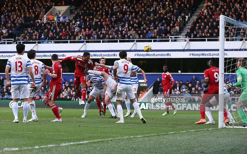 Joleon Lescott of West Brom heads the opening goal during the Barclays Premier League match between Queens Park Rangers and West Bromwich Albion at Loftus Road on December 20, 2014 in London, England.