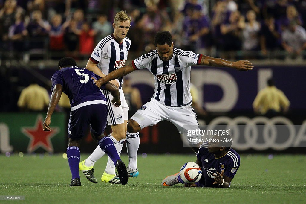 Joleon Lescott of West Bromwich Albion battles for the ball during the pre-season friendly between Orlando City and West Bromwich Albion at Orlando Citrus Bowl on July 15, 2015 in Orlando, Florida.