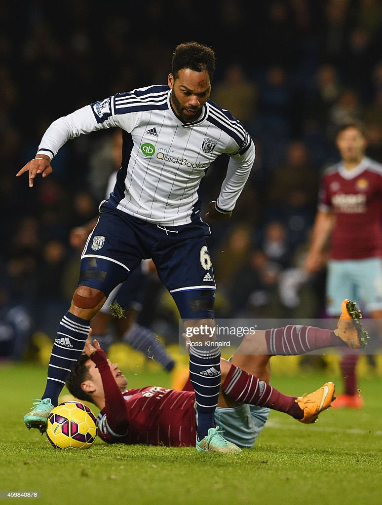 Joleon Lescott of West Bromwich Albion battles with Mauro Zarate of West Ham United during the Barclays Premier League match between West Bromwich Albion and West Ham United at The Hawthorns on December 2, 2014 in West Bromwich, England.