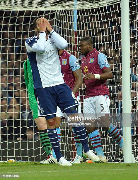 Joleon Lescott of West Bromwich Albion covers his face with his hands after a headed shot at goal goes the wrong side of the post