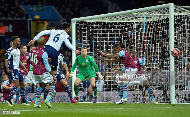 Joleon Lescott of West Bromwich Albion heads the ball towards goal but it goes the wrong side of the post