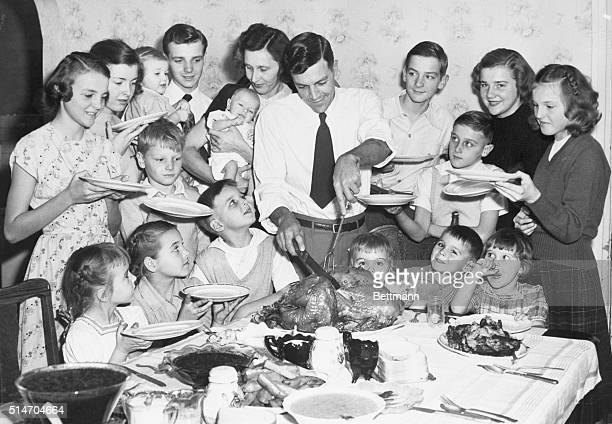 Joliet, ILL: Early Thanksgiving dinner for large family. The Raymond Baker Family of 18 members decided to celebrate Thanksgiving early so that Mrs....