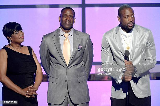 Jolinda Wade Dwyane Wade Sr and Dwyane Wade speak onstage during the 2013 BET Awards at Nokia Theatre LA Live on June 30 2013 in Los Angeles...