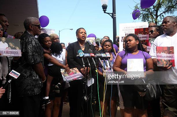 Jolinda Wade the aunt of Nykea Aldridge and mother of basketball player Dwyane Wade center speaks to reporters during a prayer vigil for her niece...
