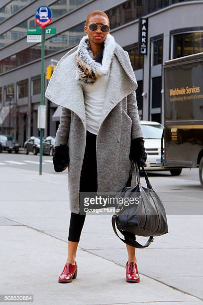 Joline Nunee seen at Skylight Clarkson Sq outside the Orley show wearing red Miz Mooz shoes oversized grey coat by Express HM pants vintage...