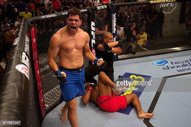 Jollyson Francisco celebrates after submitting Ewerton Rocha during their elimination fight for season three of The Ultimate Fighter Brazil on...