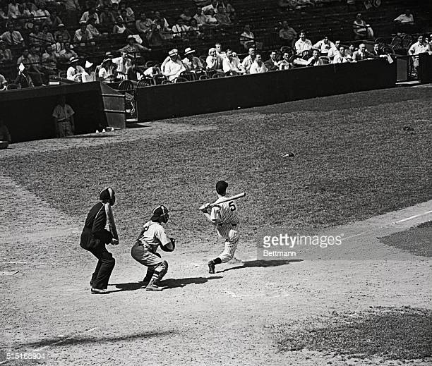 Jolting Joe DiMaggio just to prove that he doesn't do things by halves smacks out a home run in the fifth inning of today's game with the Boston Red...