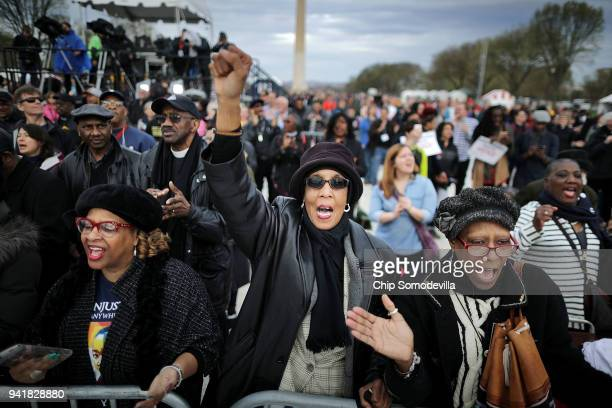 JoLynn Gilliam of East Point Georgia sings This Little Light of Mine with thousands of others on the National Mall during a prayer rally to mark the...