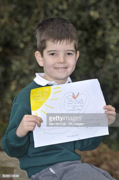 Jolyon Ellis aged six with his hand made invitation addressed to Prince William and Miss Catherine Middleton requesting their attendance for...