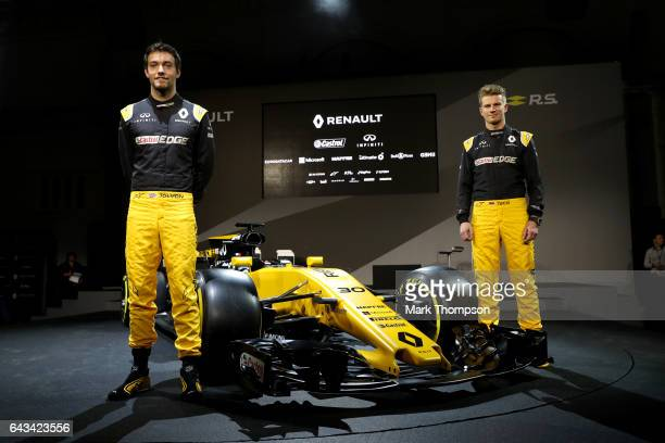 Jolyon Palmer of Great Britain and Renault Sport and Nico Hulkenberg of Germany and Renault Sport pose with the Renault Sport Formula One team's 2017...
