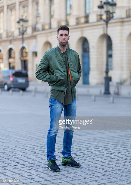 Jom Gabbar wearing green olive Alpha Industries bomber jacket tshirt GStar blue denim jeans green Nike Performance Air Max outside Lanvin on January...