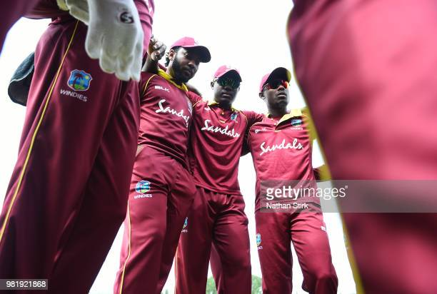 Jomel Warrican Rovman Powell and Jason Mohammed of West Indies gather in a team huddle before the TriSeries International match between England Lions...
