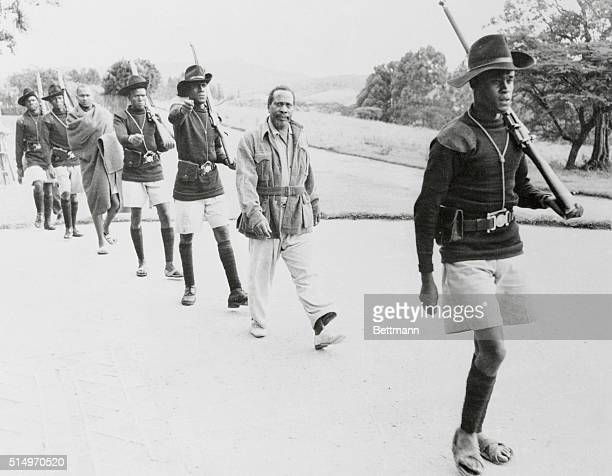 Jomo Kenyatta known as Burning Spear is followed by grimfaced guards as he is marched to the district commissioner's office in Kenya The alleged...
