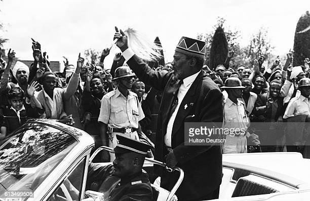 Jomo Kenyatta the Kenyan President celebrates with the cheering crowds on the country's independence day 1963