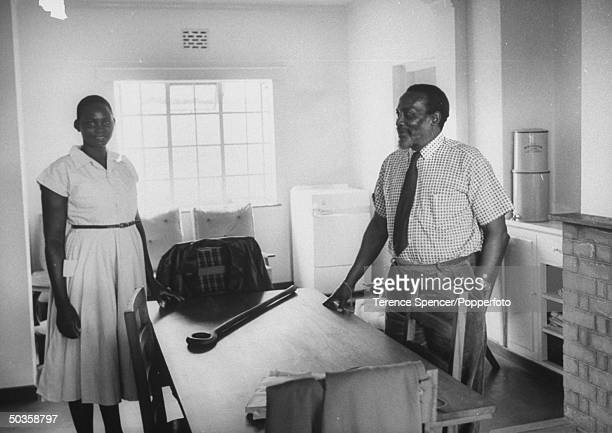 Jomo Kenyatta with his wife at their new home