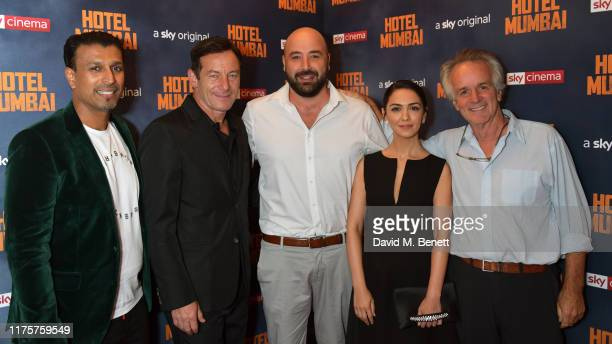 "Jomon Thomas Jason Isaacs, Anthony Maras, Nazanin Boniadi and John Collee attend a Gala Screening of ""Hotel Mumbai"" at The Electric Cinema, on..."
