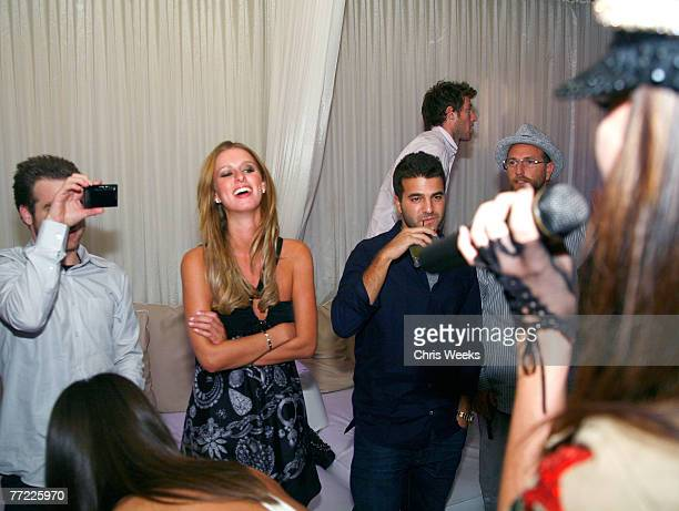 LAS VEGAS OCTOBER 6 Jon Alagem from left Nicky Hilton and David Katzenberg attend an evening hosted by Paris Hilton and Nicky Hilton at PURE...