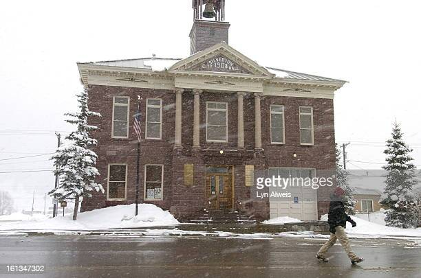 Jon Allen <cq> walks by the Silverton City Hall built in 1908 in Silverton Colorado in a snowstorm A spring storm in the southwestern part of...