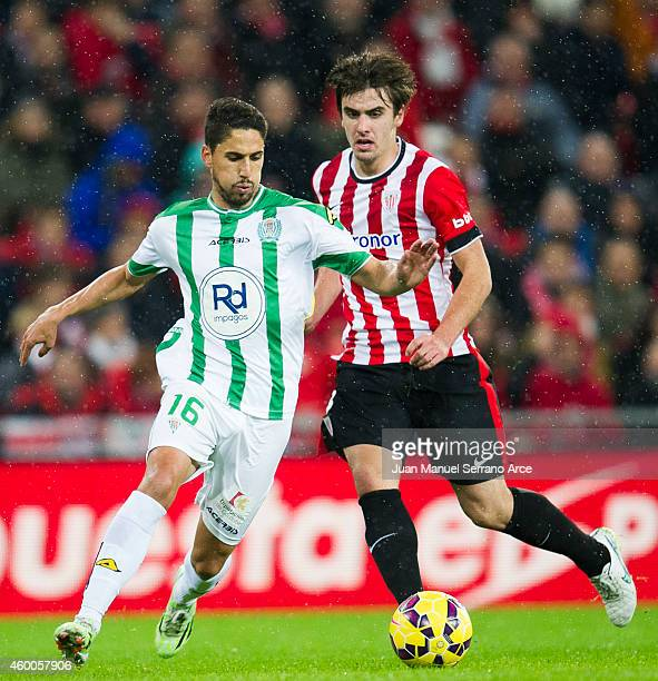 Jon Aurtenetxe of Athletic Club duels for the ball with Fidel Chavez of Cordoba CF during the La Liga match between Athletic Club and Cordoba CF at...