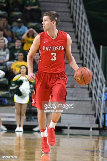Jon Axel Gudmundsson of the Davidson Wildcats dribbles the ball during a college basketball game against the George Mason Patriots at the Eagle Bank...