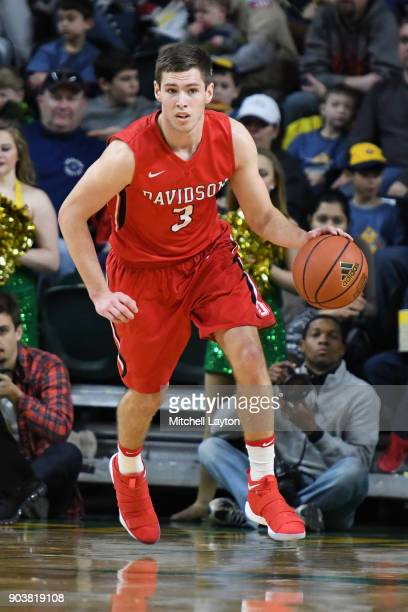 Jon Axel Gudmundsson of the Davidson Wildcats dribbles up court during a college basketball game against the George Mason Patriots at the Eagle Bank...