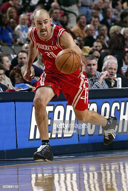 Jon Barry of the Houston Rockets moves the ball during the game with the Dallas Mavericks on January 12 2005 at the American Airlines Center in...