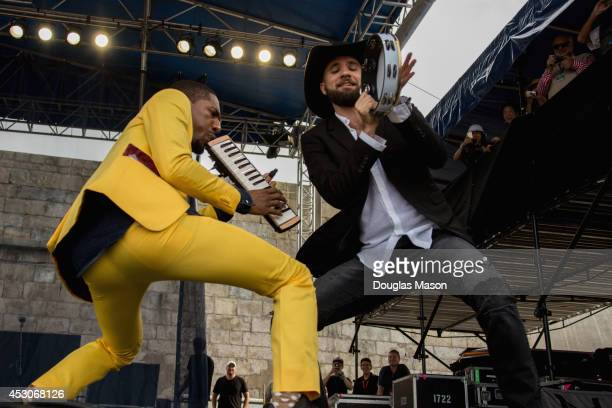 Jon Batiste and Joe Saylor of Stay Human performs during the 2014 Newport Jazz Festival at Fort Adams State Park on August 1 2014 in Newport Rhode...
