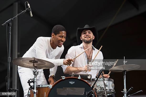 Jon Batiste and Joe Saylor perform at Fair Grounds Race Course on April 30 2016 in New Orleans Louisiana
