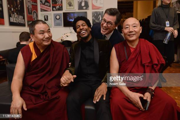 Jon Batiste and Stephen Colbert pose backstage with monks during the 32nd Annual Tibet House US Benefit Concert Gala at Carnegie Hall on February 07...