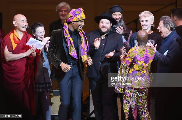 Jon Batiste Nathaniel Rateliff Leo Heiblum Angelique Kidjo and Philip Glass perform on stage during 32nd Annual Tibet House US Benefit Concert Gala...