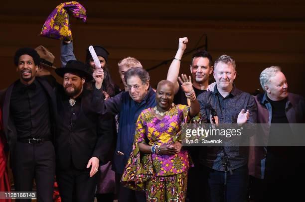 Jon Batiste Nathaniel Rateliff Leo Heiblum Philip Glass Angelique Kidjo Tom Chapman Stephen Morris and Bernard Sumner perform the finale on stage...