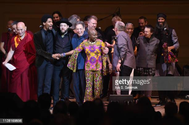 Jon Batiste Nathaniel Rateliff Philip Glass Angelique Kidjo Bernard Sumner Tenzin Choegyal and Laurie Anderson perform on stage during 32nd Annual...