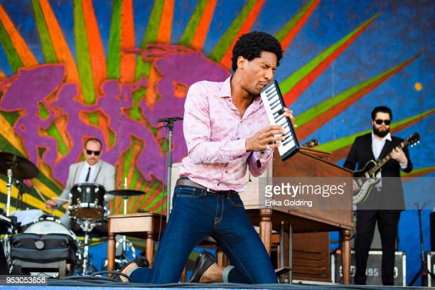 Jon Batiste performs during the New Orleans Jazz & Heritage Festival at Fair Grounds Race Course on April 29, 2018 in New Orleans, Louisiana.