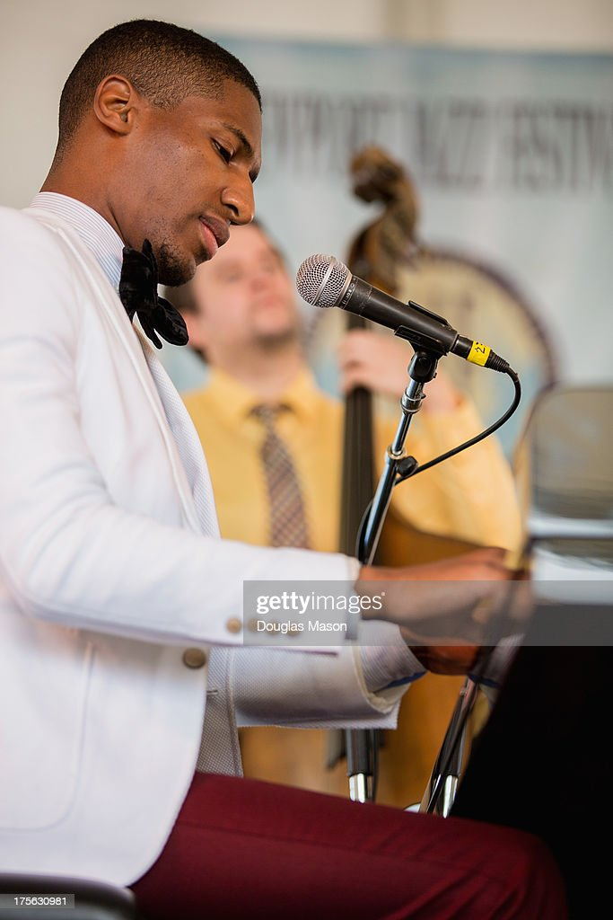 Jon Batiste performs during the Newport Jazz Festival 2013 at Fort Adams State Park on August 4, 2013 in Newport, Rhode Island.