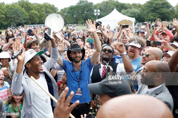 Jon Batiste Stay Human lead a second line through the crowd during the 2017 Louis Armstrong's Wonderful World Festival at Flushing Meadows Corona...