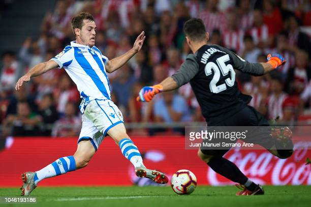 Jon Bautista of Real Sociedad being fouled by Unai Simon of Athletic Club and forced the penalty shoot during the La Liga match between Athletic Club...