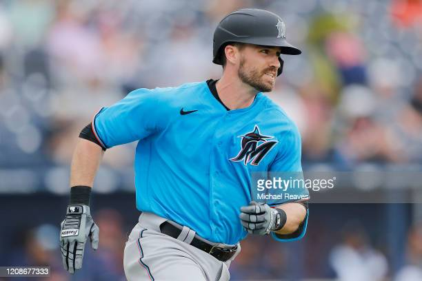 Jon Berti of the Miami Marlins runs the bases after hitting a triple against the Houston Astros in the fifth inning of a Grapefruit League spring...