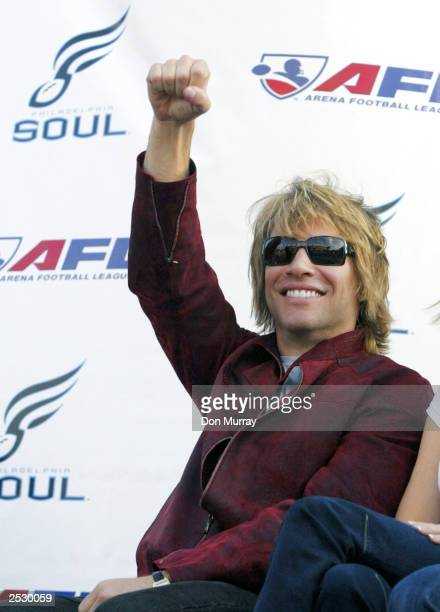 Jon Bon Jovi acknowledges the cheering crowd as he attends a rally to announce the Philadelphia Soul as the newest team in the Arena Football League...